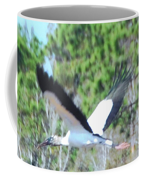 In Full Flight Coffee Mug featuring the photograph Wood Stork by Robert Floyd