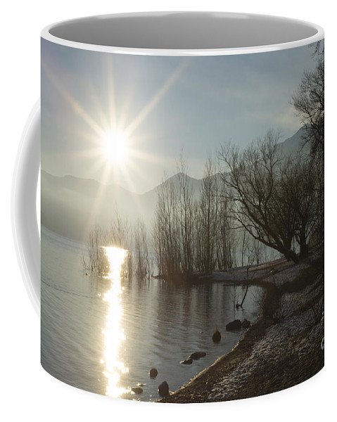 Sun Coffee Mug featuring the photograph Sunshine Over An Alpine Lake by Mats Silvan