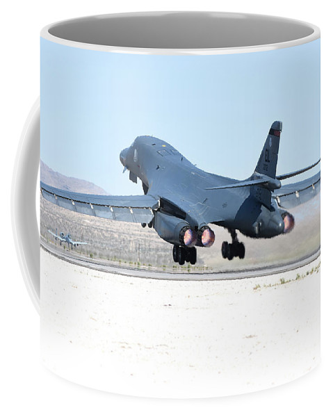Nellis Air Force Base Coffee Mug featuring the photograph A B-1b Lancer From 28th Bomb Wing by Riccardo Niccoli