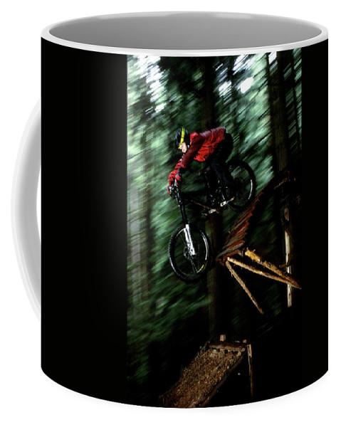 Biker Coffee Mug featuring the photograph A Biker Rides His Mountain Bike by Scott Markewitz