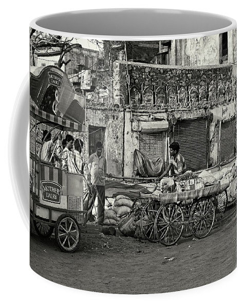 Asia Coffee Mug featuring the photograph A Chat Among Friends by Roberto Pagani
