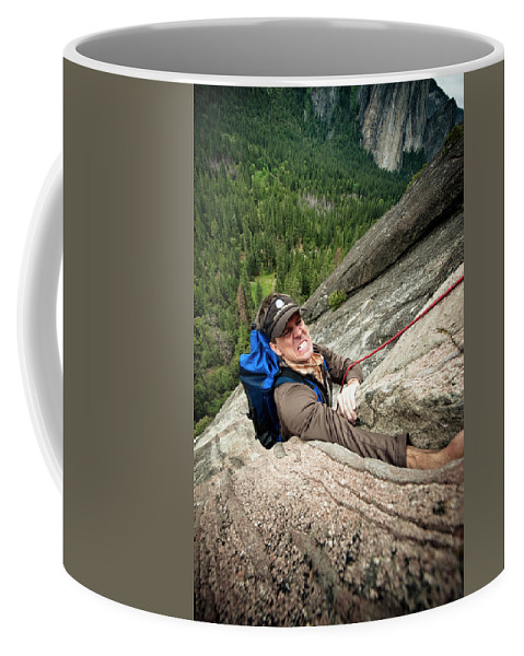 Adult Coffee Mug featuring the photograph A Climber Reaches His Hand In A Crack by Kevin Steele