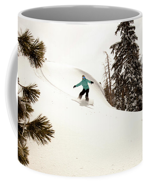 California Coffee Mug featuring the photograph A Female Snowboarder Lays Out Some by Kyle Sparks