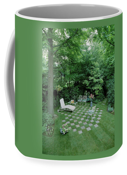 Decorative Art Coffee Mug featuring the photograph A Garden With Checkered Pavement by Pedro E. Guerrero