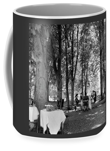 Food Coffee Mug featuring the photograph A Group Of People Eating Lunch Under Trees by Luis Lemus
