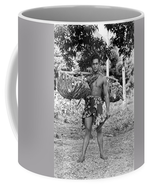 1920 Coffee Mug featuring the photograph A Hawaiian With Coconuts by Underwood Archives