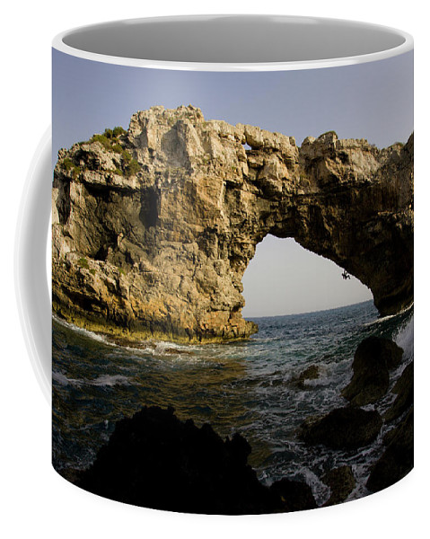 Action Coffee Mug featuring the photograph A Man Rock Climbing Deep Water Soloing by Corey Rich