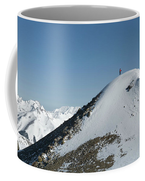 Adult Coffee Mug featuring the photograph A Man Stands Atop A High Ridge Line by Kennan Harvey