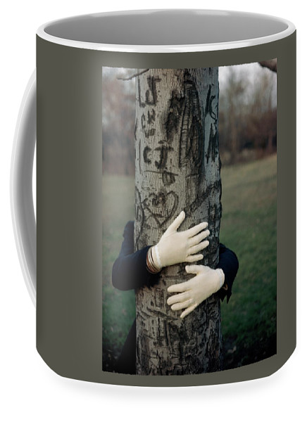 Fashion Coffee Mug featuring the photograph A Model Hugging A Tree by Frances Mclaughlin-Gill
