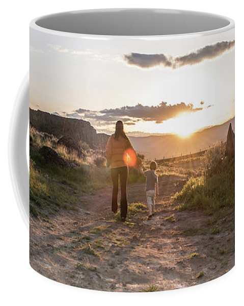 30-34 Years Coffee Mug featuring the photograph A Mother And Child Hike At Sunset by Alasdair Turner