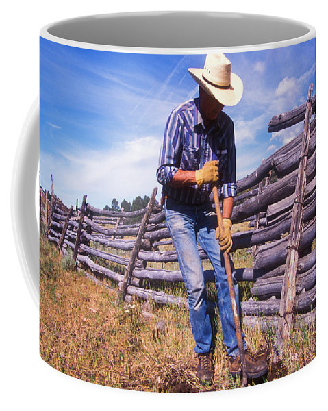 Adult Coffee Mug featuring the photograph A Old Man Digging A Hole In The Ground by Peter McBride