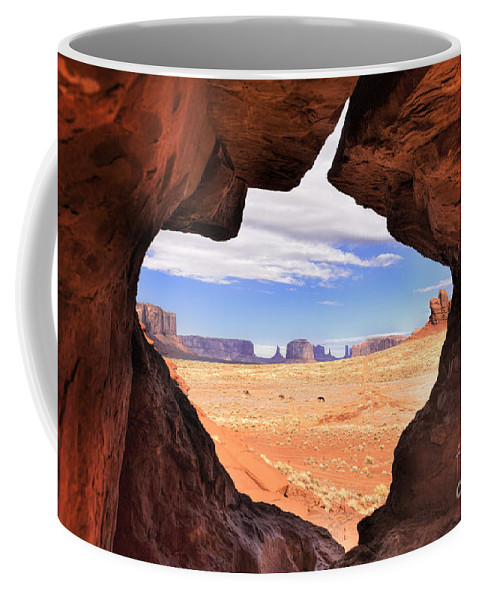 Southwest Coffee Mug featuring the photograph A Peek Into Monument Valley by Sandra Bronstein