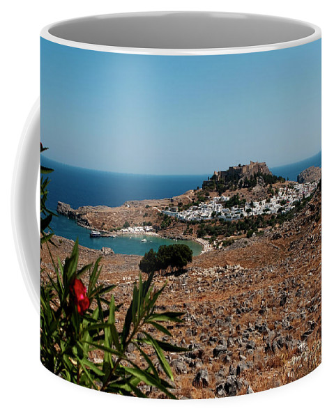 The Island Of Rhodes Coffee Mug featuring the photograph A Red Flower To Lindos by Lorraine Devon Wilke