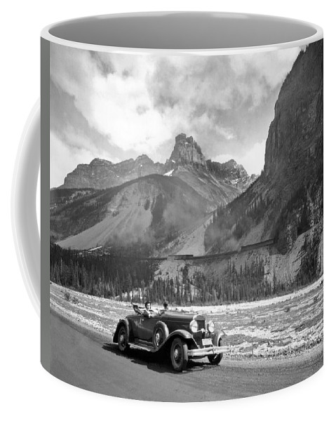 1035-654 Coffee Mug featuring the photograph A Roadster In The Rockies by Underwood Archives