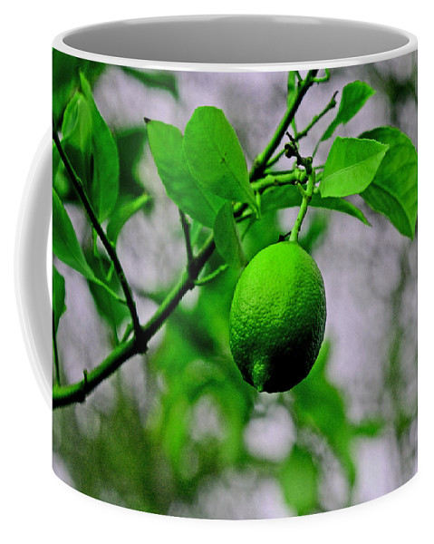 Limes Coffee Mug featuring the digital art A Single Lime by Joseph Coulombe