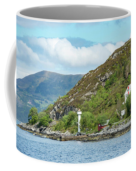 Waterfront Coffee Mug featuring the photograph A Small House With A Navigational by Brandon Huttenlocher