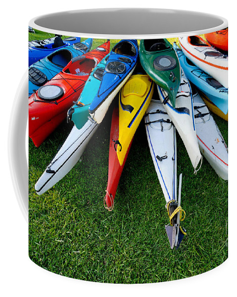A Lot Coffee Mug featuring the photograph A Stack Of Kayaks by Amy Cicconi