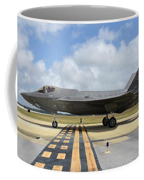 Eglin Air Force Base Coffee Mug featuring the photograph A U.s. Air Force F-35a Taxiing At Eglin by Riccardo Niccoli