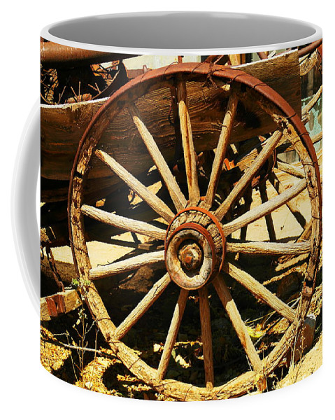 Rounds Coffee Mug featuring the photograph A Wagon Wheel by Jeff Swan