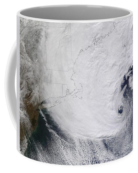 Snowstorm Coffee Mug featuring the photograph A Winter Storm Over Eastern New England by Stocktrek Images