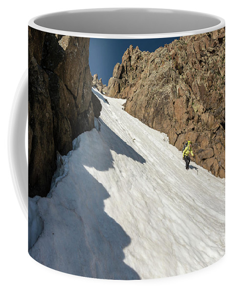 Low Angle View Coffee Mug featuring the photograph A Woman Descending A Snow Slope While by Kennan Harvey