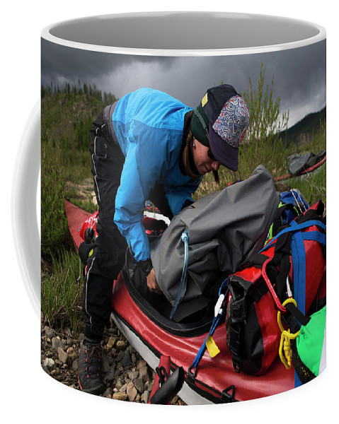 30-34 Years Coffee Mug featuring the photograph A Woman Unloads Her Kayak by Krystle Wright