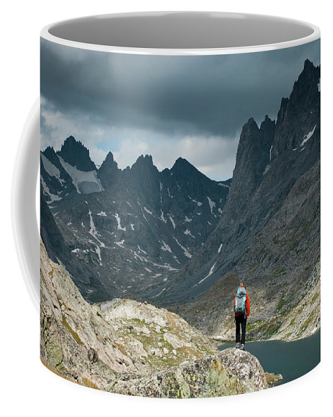 30-34 Years Coffee Mug featuring the photograph A Young Woman Takes In The View While by Jeff Diener