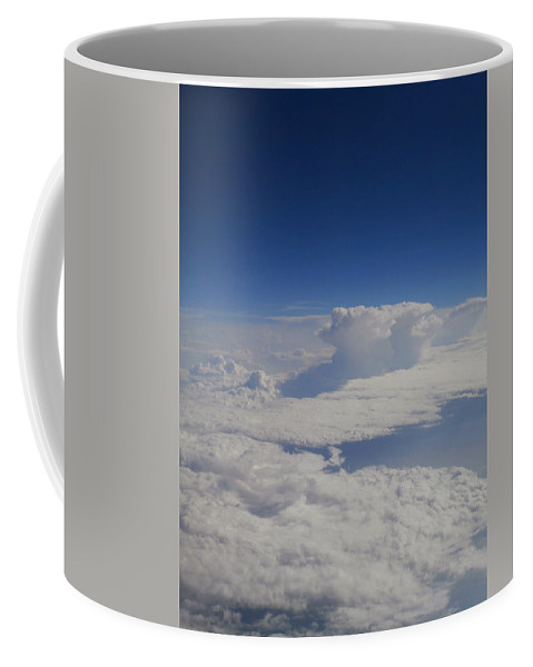 Clouds Coffee Mug featuring the photograph Above The Clouds by Dan McCafferty