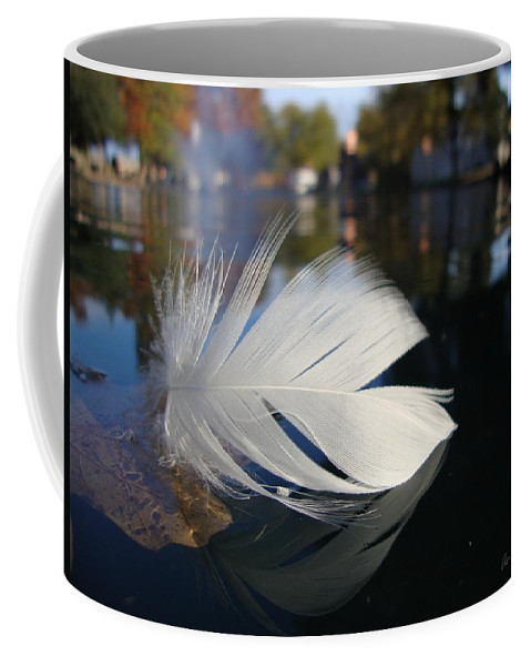Feather Coffee Mug featuring the photograph Afloat by Annie Adkins