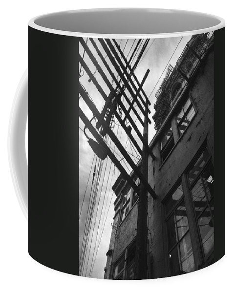 Street Coffee Mug featuring the photograph Against All Angles by The Artist Project