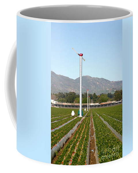 Agricultural Coffee Mug featuring the photograph Agricultural Windmills by Henrik Lehnerer