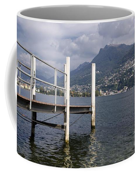 Lake Coffee Mug featuring the photograph Alpine Lake And A Jetty by Mats Silvan