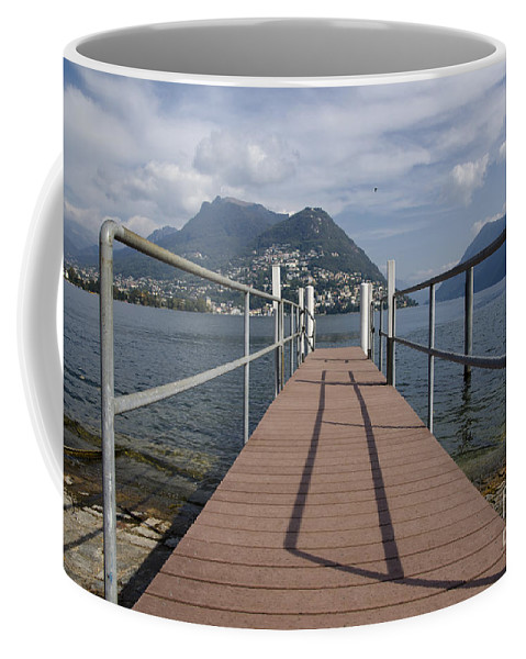 Lake Coffee Mug featuring the photograph Alpine Lake With A Pier by Mats Silvan