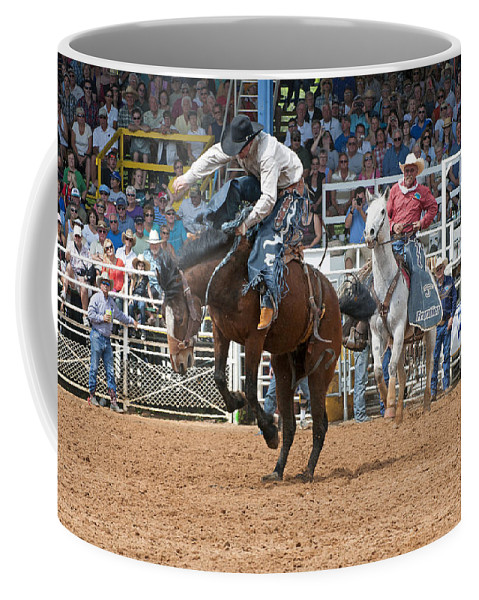 Rodeo Coffee Mug featuring the photograph American Cowboy Riding Bucking Rodeo Bronc II by Sally Rockefeller