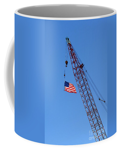 Flag Coffee Mug featuring the photograph American Flag On Construction Crane by Olivier Le Queinec