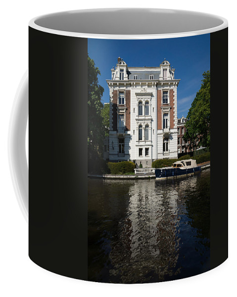 Amsterdam Coffee Mug featuring the photograph Amsterdam Canal Mansions - Bright White Symmetry by Georgia Mizuleva