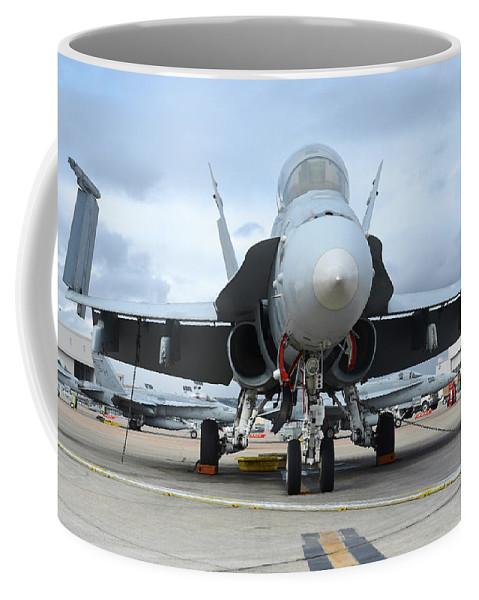 Marine Corps Air Station Miramar Coffee Mug featuring the photograph An Fa-18d Hornet On The Ramp At Marine by Riccardo Niccoli