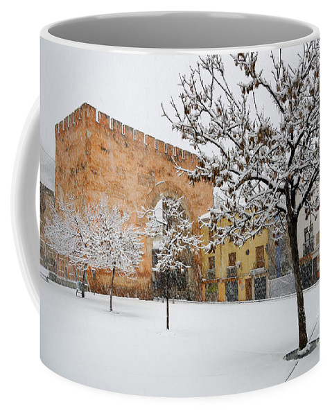 Arc Coffee Mug featuring the photograph Arc Of Elvira While A Snowstorm by Guido Montanes Castillo