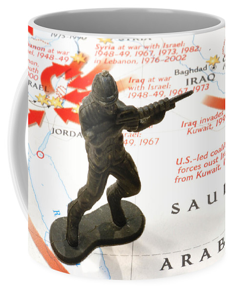 Aggression Coffee Mug featuring the photograph Army Man Standing On Middle East Conflicts Map by Amy Cicconi