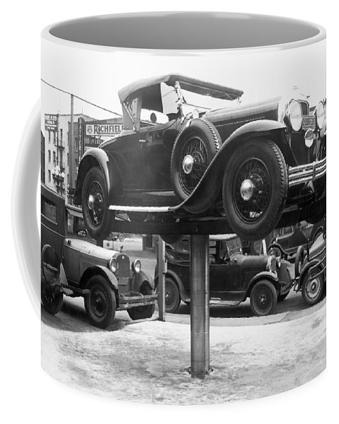 1920's Coffee Mug featuring the photograph Auto Repair Shop Lift by Underwood Archives