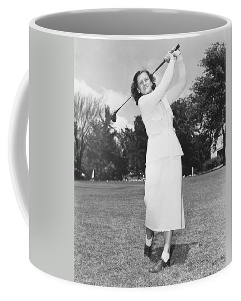 1950 Coffee Mug featuring the photograph Babe Didrikson Golfing by Underwood Archives