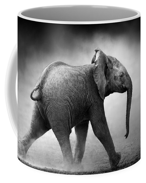 Elephant Coffee Mug featuring the photograph Baby Elephant Running by Johan Swanepoel