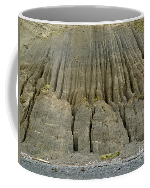 Background Coffee Mug featuring the photograph Badland Erosion Of Soft Conglomerate Sediment by Stephan Pietzko