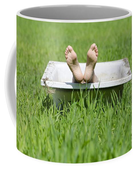 Woman Coffee Mug featuring the photograph Bathtub And Feet by Mats Silvan