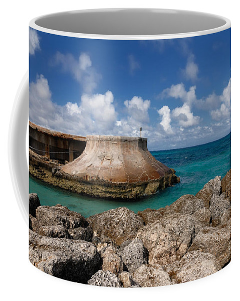 Atlantic Ocean Coffee Mug featuring the photograph Beach And Sea Wall At Atlantis Resort by Amy Cicconi