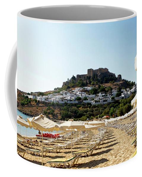 The Island Of Rhodes Coffee Mug featuring the photograph Beach View Of Lindos by Lorraine Devon Wilke