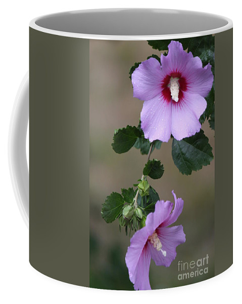 Flora Coffee Mug featuring the photograph Beauty Doubles by Jennifer E Doll
