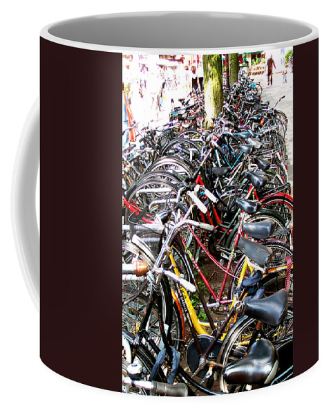 Bicycles Coffee Mug featuring the photograph Bicycles In Amsterdam by Glenn Aker