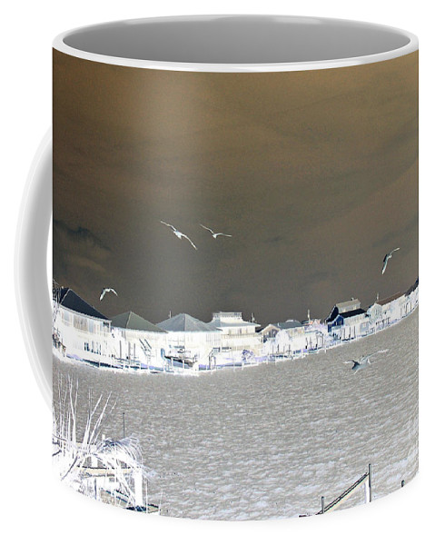 Birds In Flight Coffee Mug featuring the photograph Birds In Flight Over Lafitte Bay by Marian Bell