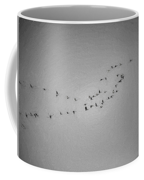 Black And White Coffee Mug featuring the photograph Black And White Monochrome Artistic Painterly On The Way To Summer Stretch Of Geese Moving North by Leif Sohlman